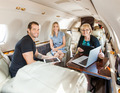 Business People Discussing In Private Jet - PhotoDune Item for Sale