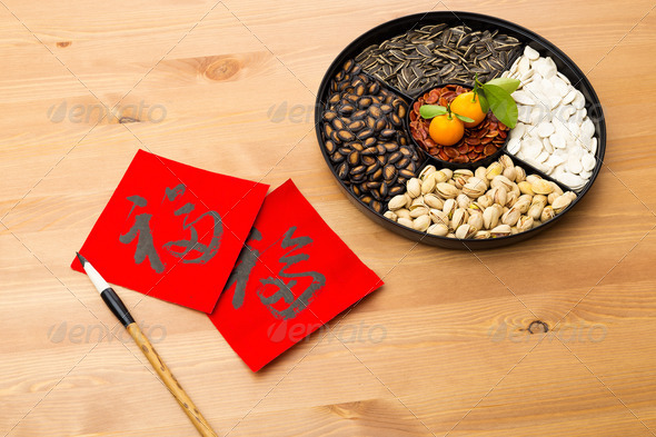 Chinese new year snack tray and chinese calligraphy, meaning for blessing good luck - Stock Photo - Images