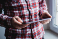 The man uses a tablet PC. Modern gadget in hand. - PhotoDune Item for Sale