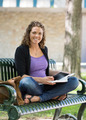 Portrait Of Happy Student Studying On Bench - PhotoDune Item for Sale