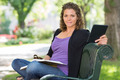 Beautiful Student Sitting On Bench At Campus - PhotoDune Item for Sale