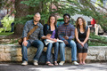 Portrait Of University Students Sitting On Campus - PhotoDune Item for Sale