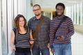 Confident University Students Standing At Corridor - PhotoDune Item for Sale