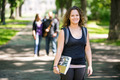 Smiling Student Standing On Campus Road - PhotoDune Item for Sale