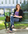 University Student With Book Studying On Campus - PhotoDune Item for Sale