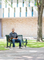 Student Sitting On Bench At University Campus - PhotoDune Item for Sale