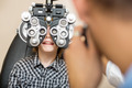 Boy Undergoing Eye Test With Phoropter - PhotoDune Item for Sale