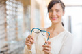 Woman Showing Glasses At Store - PhotoDune Item for Sale