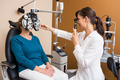Optometrist Examining Senior Woman's Eyes - PhotoDune Item for Sale