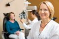 Confident Optometrist With Colleague Examining Patient - PhotoDune Item for Sale