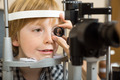 Optician's Hand Checking Boy's Eye With Lens - PhotoDune Item for Sale