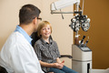 Boy Smiling While Sitting With Optometrist In Store - PhotoDune Item for Sale