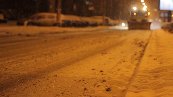 Nighttime Snow Plow Truck