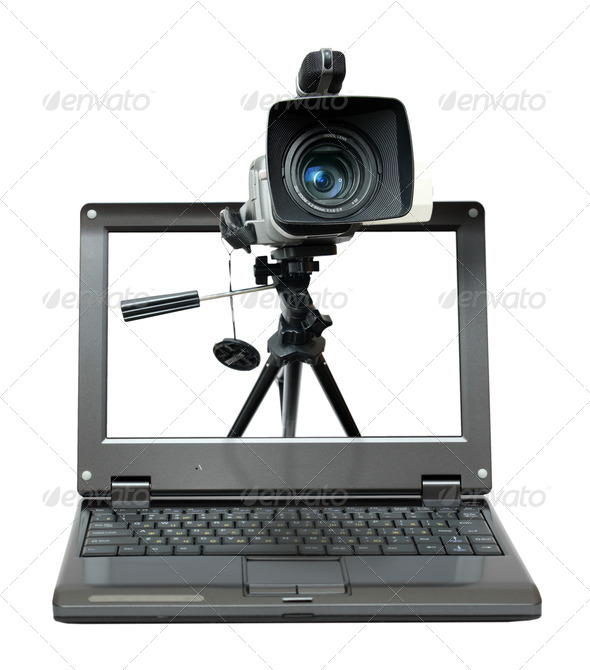 PhotoDune laptop with video camera on tripod 706510