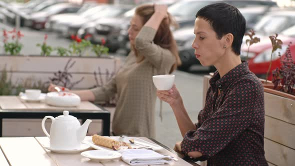 VideoHive Women Eating in Summer Street Cafe 19667564