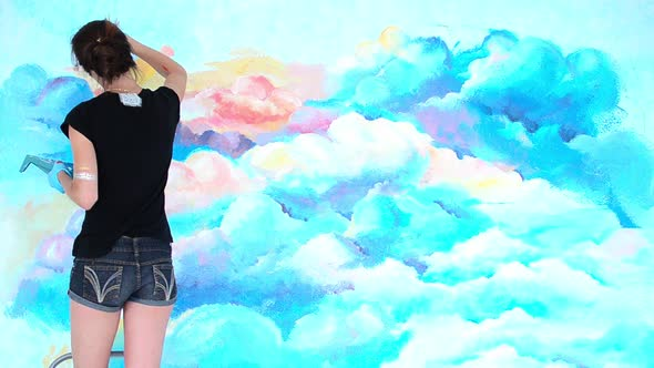 Download Woman the Artist Paints the Wall in to the Sky with Brush nulled download
