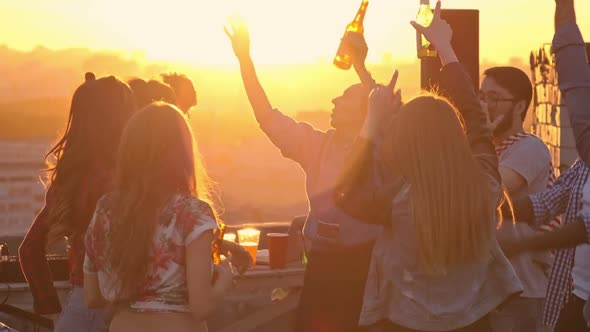 VideoHive Young Friends Hanging out at Sunset Party 18076902