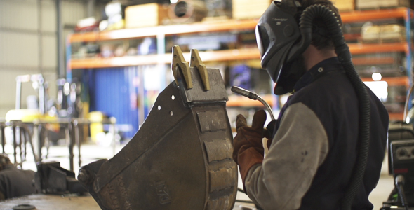 Man Wearing Safety Gear Preparing to Weld