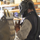Man Wearing Safety Gear Preparing to Weld - VideoHive Item for Sale