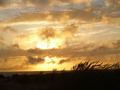 Sunset Over the Ocean with a Beach Foreground - PhotoDune Item for Sale