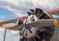 Vintage Yellow Propeller Aircraft Parked at an Airport - PhotoDune Item for Sale