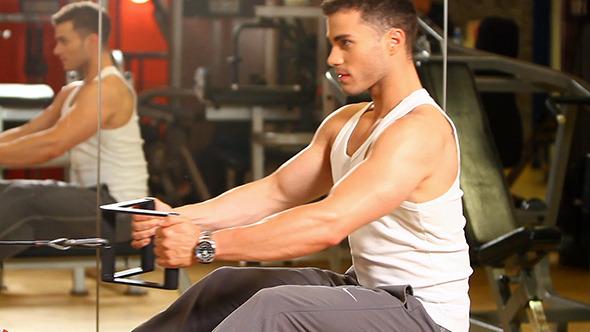 Muscular Man Doing Strength Exercises