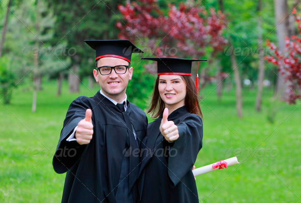 Happy Couple in the Graduation Day  - Stock Photo - Images