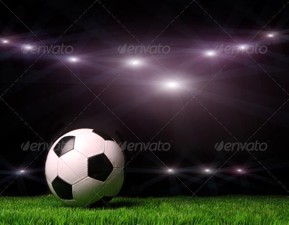 PhotoDune Soccer ball on grass against black 710692