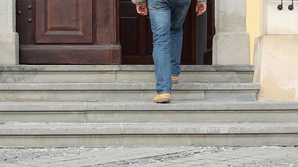 Man Enters Old Edifice