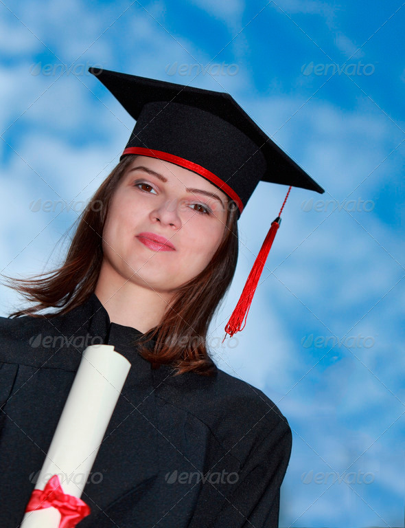 Portrait of a Woman in Graduation Gown  - Stock Photo - Images
