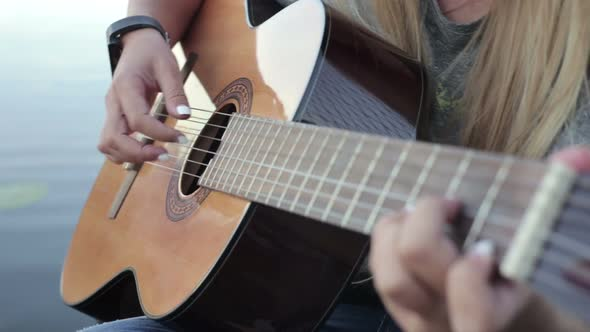 Download Girl Playing on the Guitar nulled download
