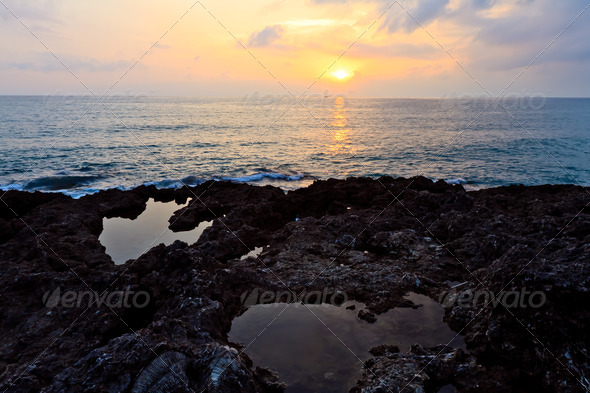 Rock of pool and sunset - Stock Photo - Images
