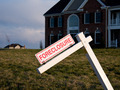 Modern house with foreclosure sign