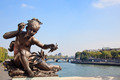 Small child statue frames view of Seine and Paris - PhotoDune Item for Sale