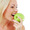 Woman bites an apple - PhotoDune Item for Sale