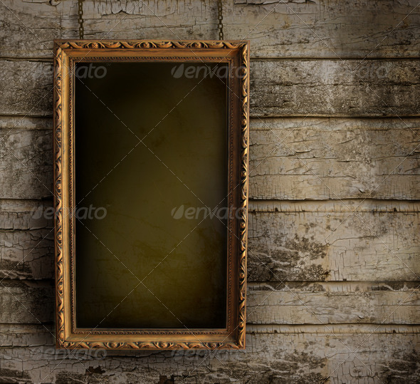 Old frame against a peeling painted wall - Stock Photo - Images