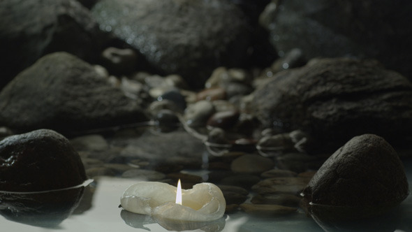 Candle is Floating Between Rocks