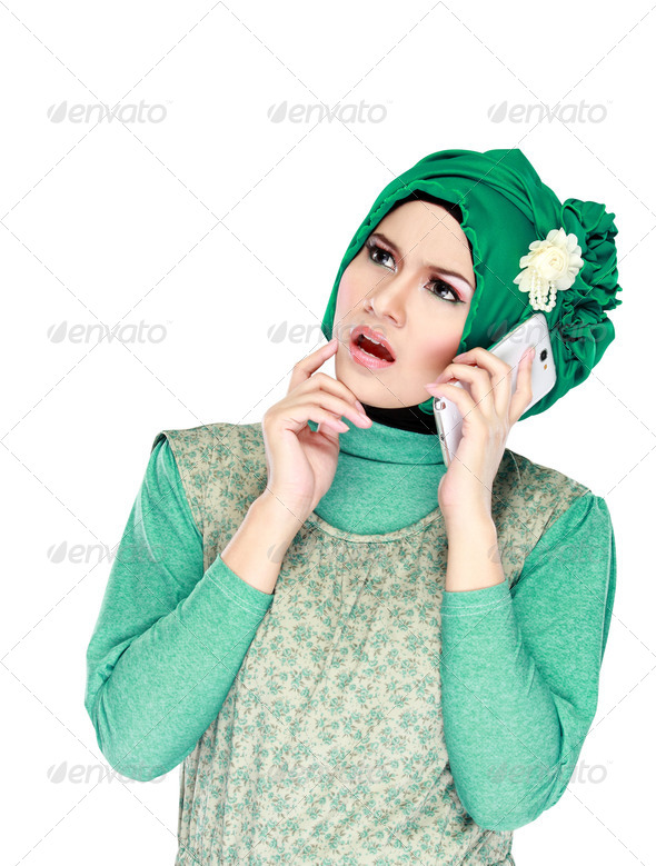 woman with head scarf calling by phone - Stock Photo - Images