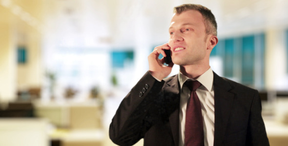 Happy Businessman Phone Conversation