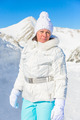 woman in ski suit on a background of mountains - PhotoDune Item for Sale