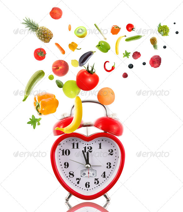 Clock in shape of heart with fruits and vegetables. - Stock Photo - Images