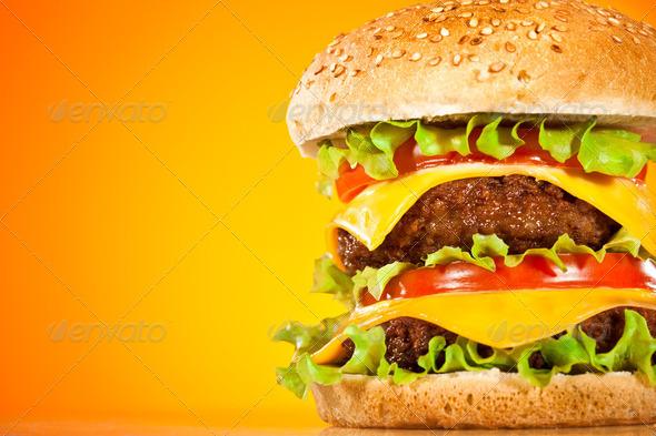 PhotoDune Tasty and appetizing hamburger on a yellow 729278