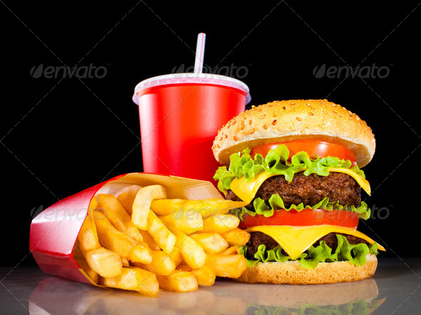 Stock Photo - PhotoDune Tasty hamburger and french fries on a dark 729734