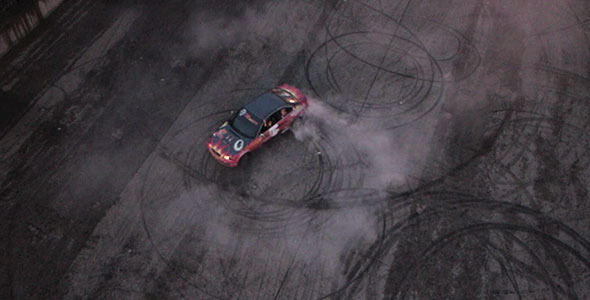 Aerial View zenithal of a Car Drifting