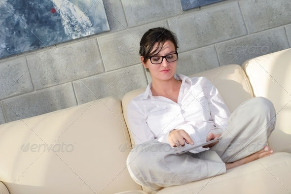 woman using tablet pc at home - Stock Photo - Images