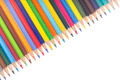 Many colorful pencils in a diagonal row isolated on white background - PhotoDune Item for Sale
