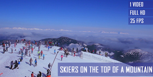Skiers On The Top Of A Mountain