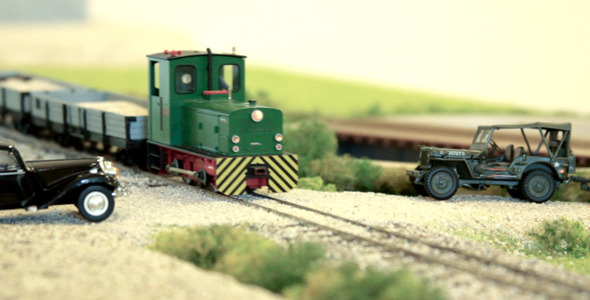 Model Train Passing By Cars