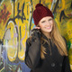 Cute blonde teenage girl with hat against graffiti wall - PhotoDune Item for Sale