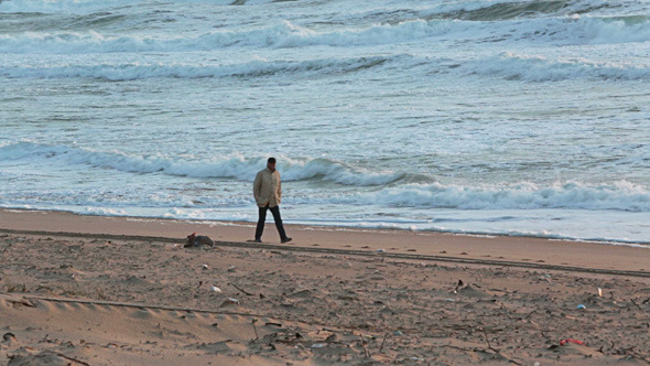 Man Walking on the Beach with Storm Waves 02